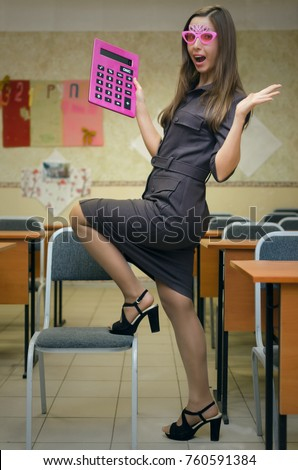 Shocked Sexy Teacher Of Economic Disciplines In Pantyhose Stockings And High Heels Shoes Posing Putting Her