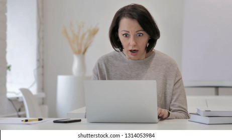 Shocked, Stunned Old Senior Woman Wondering and Working on Laptop