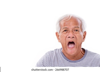 shocked, stunned, unhappy old man with surfers eye or pterygium