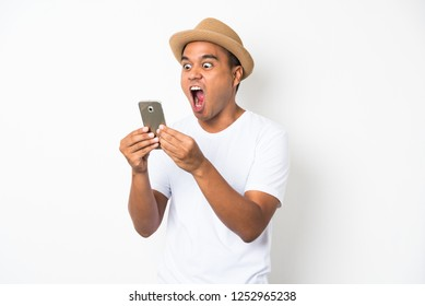 Shocked and surprised asian man looking smartphone.