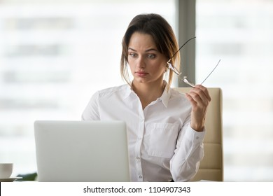 Shocked surprised businesswoman amazed by reading unbelievable online breaking news on laptop, astonished woman feels stunned dumbfounded looking at computer screen baffled by unexpected email letter