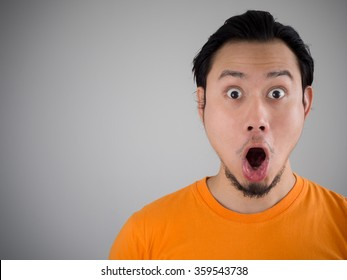 Shocked and surprised face of Asian man.