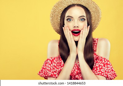 Shocked and surprised girl screaming covering  mouth her hands.Woman in straw hat  and summer dress amazed.Presenting your product.Expressive facial expressions emotions