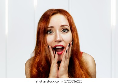 Shocked and surprised girl screaming. Curly ginger hair woman amazed with open mouth. Expressive facial expressions.