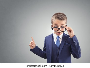 Shocked and surprised young confident executive businessman boy with copy space concept for amazement, astonishment, stunned and speechless