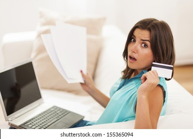 Shocked woman with credit card