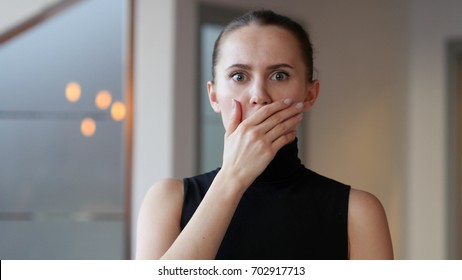 Shocked Woman in Office