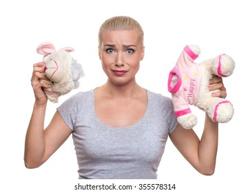 shocked woman with teddy bear. Beautiful blonde hair woman holding damaged teddy bear