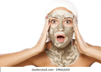 shocked young girl with a mask on her face