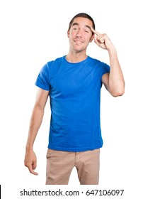 Shocked young man with a gesture of concentration against white background