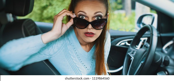 shocked young pretty woman in the car