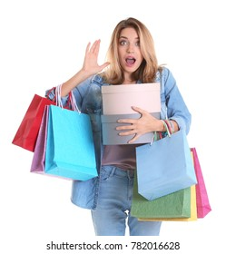 Shocked young woman with shopping bags and boxes on white background