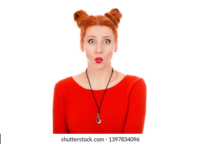 Shocking news. Closeup portrait of a beautiful woman in her 30s looking at camera stunned wearing red blouse standing posing on pure white background wall. Mixed race, Irish Hispanic, Caucasian model