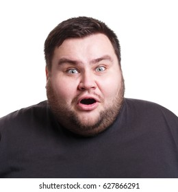 Shocking news. Surprised fat man expressing amaze on face, standing on white isolated background, studio shot