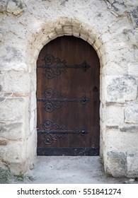 Shod wooden door in a stone wall