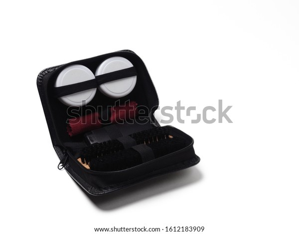 Shoe care kit, with two wooden brushes, a velour cloth for polishing and two jars of wax. Isolate on a white background