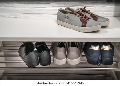 Shoe closet. Men shoes on shelves in a closet
