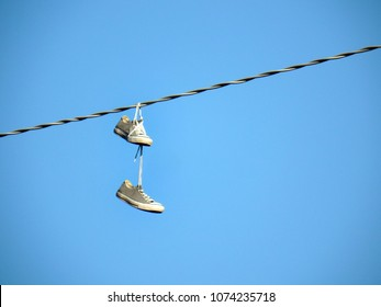 Shoe dangling or shoe flinging, is the practice of throwing shoes whose shoelaces have been tied together so that they hang from overhead wires such as power lines or telephone cables.