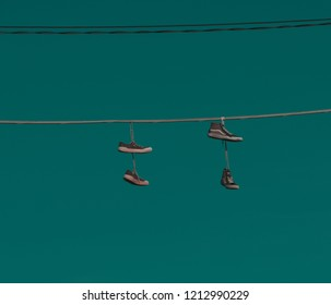 """Shoe flinging or """"shoefiti"""", shoes on the power lines."""
