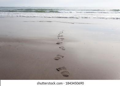 shoe marks on a clean beach