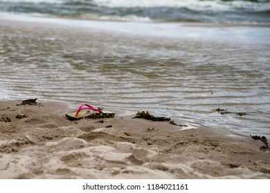 shoe on the beach, drowning person theme