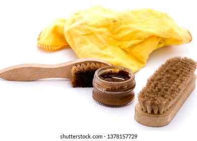 shoe polish with brushes in brown and yellow cloth