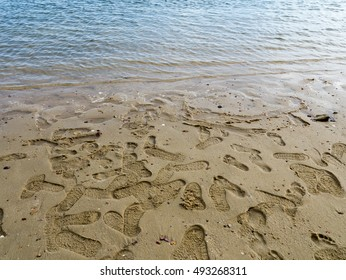 Shoe prints and footprints on the sand