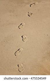 Shoe prints on the beach