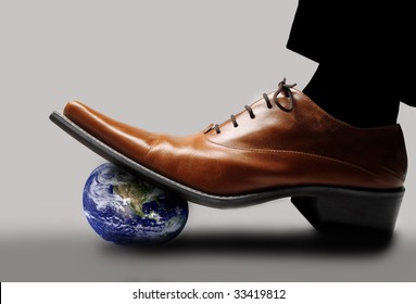 shoe stepping on planet earth