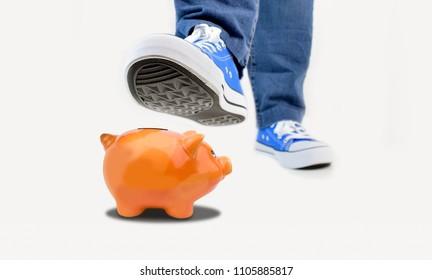 A shoe treads piggy bank as a metaphor about savings problems