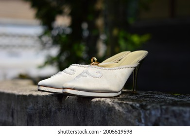 shoe and the weddingring on the wall