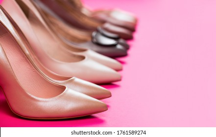 Shoe for women. Beauty and fashion concept. Fashionable women shoes isolated on pink background. Stylish classic women leather shoe. High heel women shoes on red background.