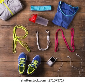 Shoelaces run sign and various running stuff on a wooden floor background