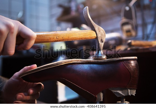 shoemaker makes and repairs shoes for men