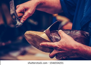 Shoemaker workshop for making shows artisan handmade manufacturing leather shoes. Shoe manufacture business for traditional vintage shoe making, craft shoes in traditional style