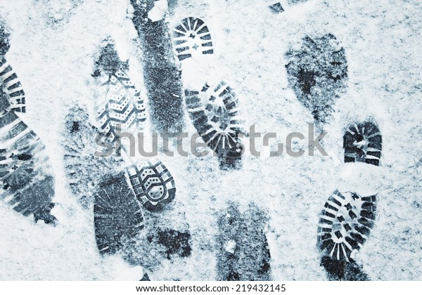 Shoeprints in snow - danger walking in the snow.