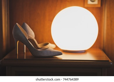 Shoes about the lamp.