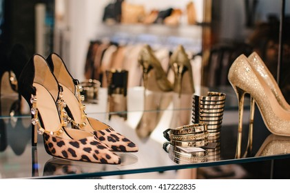 Shoes and accesories in a clothing boutique.