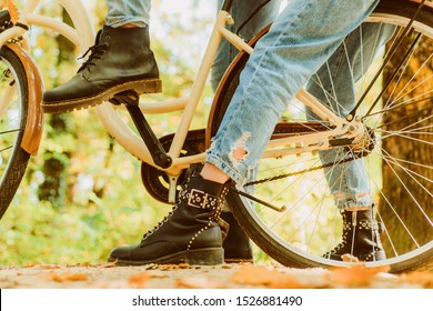 Shoes for active lifestyle. Romantic couple on date. Date and love. Couple in love ride bicycle in park. Ideas for date. Romantic date with bicycle. Unrecognizable couple with bike in autumn forest.