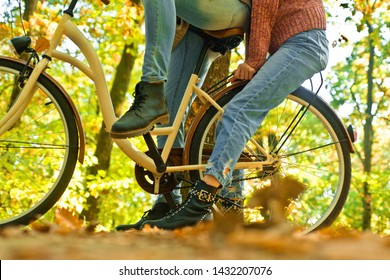 Shoes for active lifestyle. Unrecognizable couple with bike in autumn forest. Romantic couple on date. Date and love. Couple in love ride bicycle in park. Ideas for date. Romantic date with bicycle.