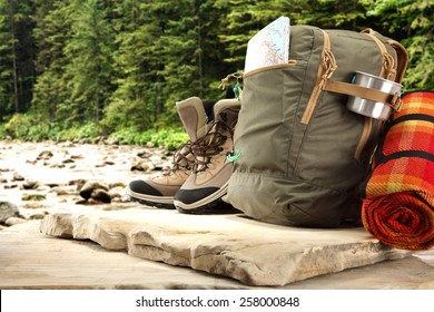shoes backpack and river background