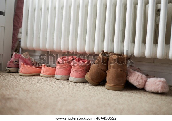 Shoes By Radiator In Family Home