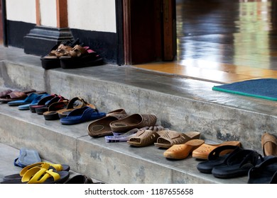 Shoes at the entrance of a Hinduist temple