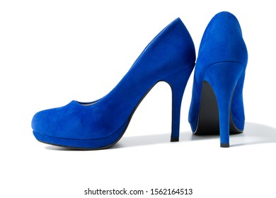 Shoes fashion woman closeup. Close-up high heels pair women shoes isolated on white background. Elegant luxury female Blue footwear on floor. Stylish suede shue. Selective focus.
