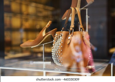 Shoes and handbag in a display of a luxury store