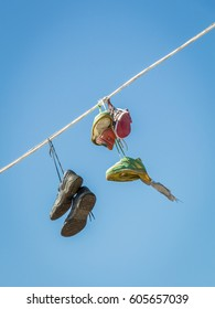 Shoes Hanging on a Phone Wire