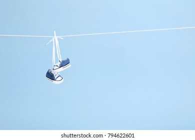 shoes hung out on a clothesline