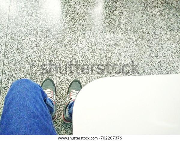 Shoes jeans floor tables