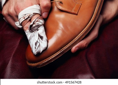 Shoes master polishing shoes with cloth (bull shoes)(Glacage).shoes shining.closeup