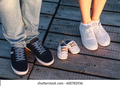 Shoes mom, dad and kid is on the wooden floor